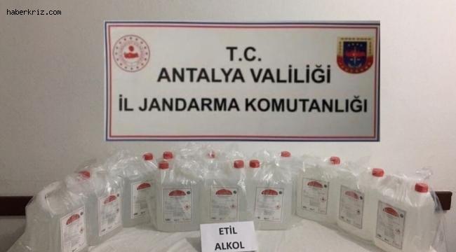 Kaş'ta evde kaçak olarak üretilen 60 litre etil alkol ele geçirildi